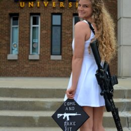 Urge Kent State Graduate to Remove and Apologize for Grad Photos with AR-10